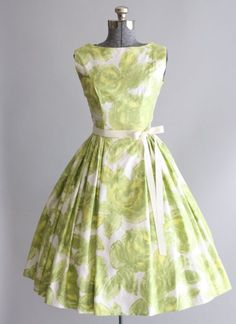 Cute white and green vintage dress with a floral pattern.