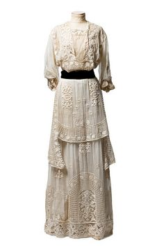 Marquisette dress covered with embroidery and lace insertion with a black velvet belt [American], c. 1910
