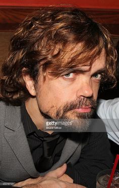 Peter Dinklage poses at the opening night party for 'Taking Care of Baby' at Faces & Names Lounge on November 19, 2013 in New York City.