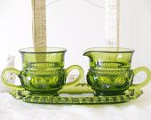 Depression glass creamer and sugar with tray. Olive green, in beautiful condition with no cracks or chips.