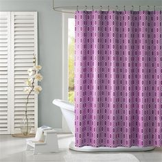Viva is a great way to add style to your bathroom. This shower curtain is covered in a white geometric inspired print atop a purple backdrop. Made from polyester this shower curtain is machine washable for easy care.