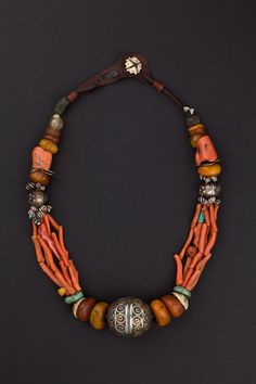 Western Anti-Atlas, Morocco | Silver, enamel, coral, amber, shell, amazonite, glass and leather Berber necklace. | ca. 1st half 1900s. | 2,900€