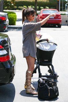 Kourtney Kardashian takes her little ones to the farmer's market looking fab in a khaki shirt dress and knee high sandals
