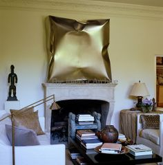 Richard Shapiro | A stainless steel sculpture by Ewerdt Hilgemann hangs above the fireplace in the drawing room