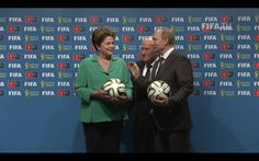 From Brazil to Russia: symbolic hand-over at the Maracana, Rio de Janeiro, 13 July 2014. Sepp Blatter, president of FIFA, stands between Russian president Vladimir Putin and Brazilian president Dilma Rousseff in this grab from the official FIFA video of the event. Russia will host the 2018 Fifa World Cup.