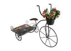 Bicicleta de Ferro Porta Revistas e Vaso        Produto artesanal feito em ferro e arame recozido, pintado com esmalte sintético e verniz para uma melhor proteção e acabamento na peça.        Muito prática e decorativa        Dimensões do Produto:        50cm de altura        35cm de largura        75cm de comprimento            O vaso com flores e as revistas não acompanham o produto            PRAZO DE ENTREGA: EM ATÉ 5 DIAS ÚTEIS PARA PRODUÇÃO, MAIS O PRAZO DOS CORREIOS R$ 140,00