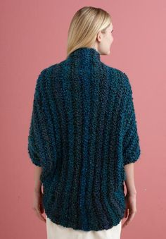 Lion Brand crochet shrug. Pretty much large rectangle, fold in half leave holes for arms and sew down