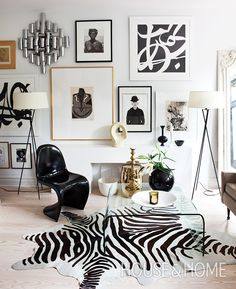 A faux zebra hide is perfectly in step with the sharp black and white art and furnishings in this living room, designed by Christine Ralphs. | Design: Christine Ralphs Photo: Virginia MacDonald