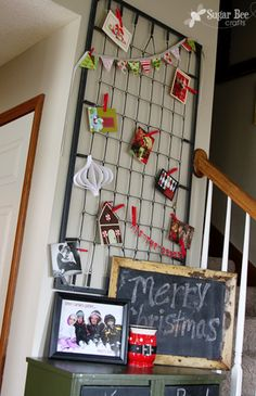 Love it! It's a old crib spring, she hung on the wall and hung up christmas cards!