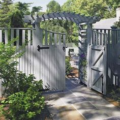 fence with panels @ top, arched arbor over fence, great fence hardware