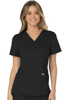 """A Modern Classic fit mock wrap top features front shoulder yokes, two patch pockets, instrument loop, logo label with bungee loop, front and back princess seams and side vents. Center back length: 26"""" Sizes: XXS - 5XL Color: Black (BLK) Brand: Cherokee Workwear"""