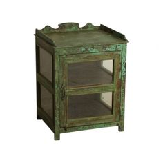 Green 1-door cabinet - We travel through India to find to most beautiful and unique cabinets. Without losing the story of their past we fix the cabinets where necessary, while keeping them as original as possible. Our mission is to pass them on to a new home where they will be appreciated for many years to come.