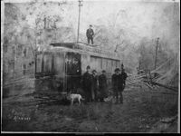 Gainesville, winter 1909. Men standing beside a streetcar on North Green Street during an ice storm.