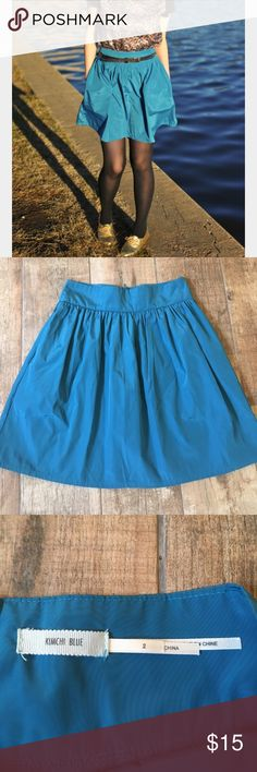 Kimchi Blue Skirt Fun teal colored Kimchi Blue skirt with pockets. Shiny fabric and band waist helps accentuate the waist. Perfect condition. Urban Outfitters Skirts