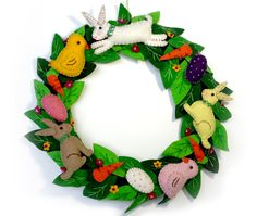"12"" Wool Felt Applique Wreath with Bunnies and Chicks and Eggs Motif Pattern Easter or Baby Shower by FeltPassion on Etsy https://www.etsy.com/listing/189666745/12-wool-felt-applique-wreath-with"