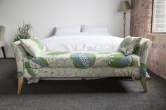 Anna bed end bench covered in Christopher Farr Carnival Indoor Green Linen