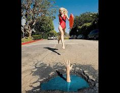 Lifeguard (© Rex)  Potholes can be dangerous so before you go swimming in one make sure there's a lifeguard.
