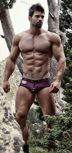 Fitness model Sergi Constance wearing a grape colored speedo