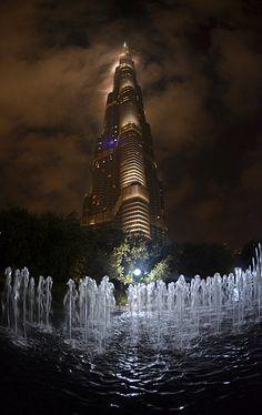 """""""Dubai Burj Khalifa in the clouds Feb 2012"""" by Alex Connock on flickr"""