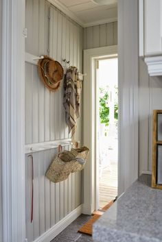 Painted beadboard entry with coat racks Cheap Beach Decor, Cheap Home Decor, Cottage Hallway, Swedish Cottage, Simple House, Interiores Design, Home Decor Accessories, Mudroom, Farmhouse Decor