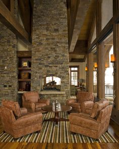 I like the gray and tan stone fireplace.  This is my favorite trim color.  You could still use dark mahogany furniture with it.  High-end Interior Design Firm, Decorators Unlimited