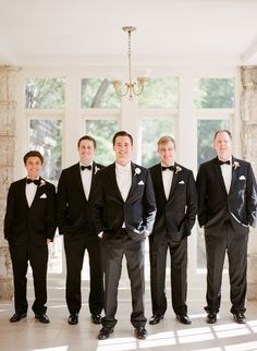 Groom Style -- Groom with Classic White BowTie -- Groomsmen Black Bowties - See the wedding: http://www.StyleMePretty.com/2014/06/03/timeless-austin-wedding-at-chateau-bellevue/  SMP - Photography: TaylorLord.com