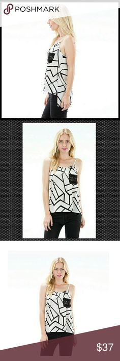 """Ivory & Black Tank Top Ivory (not white) abstract printed tank. Camisole. This top includes a pocket on the front left.   Made in the USA. 96% polyester and 4% spandex.   Brand New tank top. Excellent condition. High-low style. The front length measures 24.5"""" and the back measures 28"""" long.   Excellent, new classy tank top!! Tops Tank Tops"""