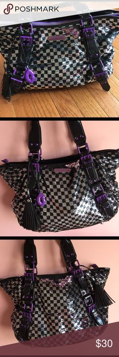 Betsy Johnston tote purse Betsey johnson purple & black sparkled tote purse . Took pictures all around and inside of purse . Has a big purple zipper with shiny tassel and cute purple lip kiss attatched for accessory!! Bag is in great condition! Betsey Johnson Bags Totes