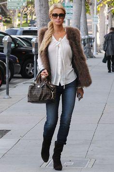 Paris Hilton in LA wearing white blouse, skinny jeans & fur gilet. Celebrity street style / fashion.