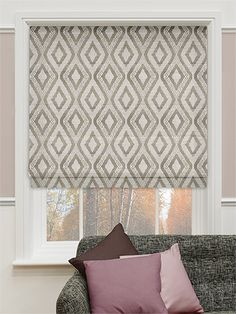 This geometrically patterned roman blind has wonderfully soft and creamy coffee tones that lend it warmth and allow it to sit beautifully in a whole range of design schemes.