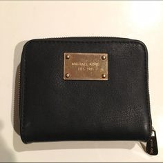 Michael Kors black leather wallet Black leather wallet with gold detailing, 10 card slots, money holder, and zipper change pouch on side. 100% leather. Has wear on Michael Kors plaque as shown in last photo. Michael Kors Bags Wallets
