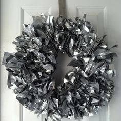 Newspaper wreath Gather newspaper in bunches, use zip ties to attach to wire wreath. Spray paint.