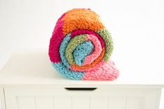 Over the Rainbow Afghan - Play with multiple shades and colors to get the look of this crochet afghan. Subscribe to I Like Crochet to get the pattern.