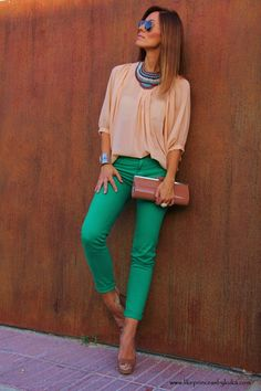 Green pants paired with muted peach blouse? Actually love the color combo and the entire look.