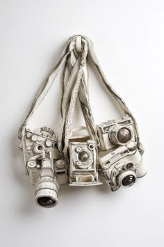 3D artwork by Katharine Morling, the English artist who do white #sculptures in porcelain and ceramic of still-life objects. Here we have five #cameras