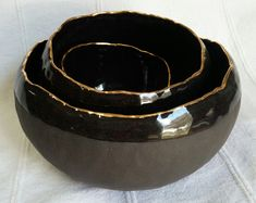 Babushka bowls, Ceramic Bowl Set of 3, Salad Bowl, black clay, black and gold, gold line, home decor, black stoneware bowl, gift for her  Pinch pots. When you speak of handcraft in the most literal sense of the word you should be here. These pitch pots were fully kneaded by hand and not a single tool has been used, for example to decorate or smoothen the surface.  Pinch pots are also one of the most primitive techniques to make utensils of clay.  The pinch pots shown here have been made by…