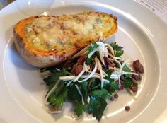Baked butternut squash with leeks and hazelnuts