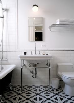 classic black and white bath with great washstand sink, quilt pattern floor tile, subway tile with narrow black border, Brooklyn, NYC