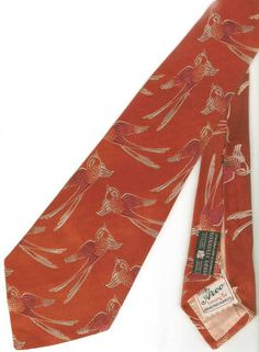 In the middle 1930s, brocade ties were very, very common. They came in apparently endless varieties of patterns and motifs.Made by Arco, a big maker, and features a very nicely rendered swallow motif.