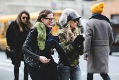 Lessons In Layering From The Streets Of New York City #refinery29  http://www.refinery29.com/2016/02/103173/ny-fashion-week-fall-winter-2016-street-style-pictures#slide-176  Green fur and camo stand out in a sea of black....