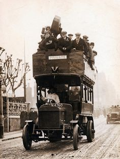 c. 1905. Early double decker bus.