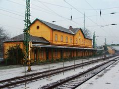 TATA, HUNGARY RAILWAY STATION IN WINTER }{ The area has been inhabited since prehistoric times; archaeological findings date back to 50,000 BCE. Later it was a Roman settlement. The first known mention of Tata is from 1221.