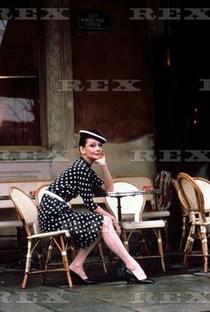 The actress Audrey Hepburn photographed by Sergio Strizzi for a fashion editorial at the restaurant Aux Deux Magots in Paris (France), in March 1979.