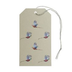 We think that wrapping up presents is just as much fun as opening them and our lovely range of Gift Tags will make that gift extra special! These Pheasant Gift Tags come in a pack of ten with grey thread ties. The reverse of the tags has been left blank for your message. These adorable gift tags feature six magnificent flying Pheasant birds on a stone green background. Perfect if you're wrapping something up in our Pheasant Gift Wrap. Have a peek at the matching Ribbon options too!