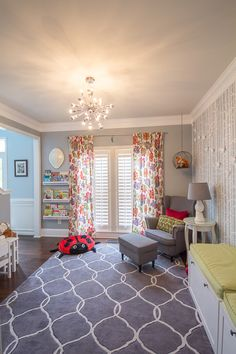 Colorful modern children's playroom - gray rug, Ikea furniture, play kitchen, zgallerie orbit light fixture, floral curtains, colorful accessories