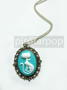 Sassy Cat Victorian Cameo Pendant   This is a lovely little bauble to add to any Candy lolita ensemble or simply be worn daily. It is also beautiful to wear with daily clothes. A wonderful birthday present for girls who has a love for something mod and vintage at the same time.  Cameo: 30x40m...