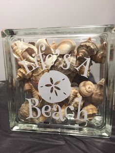 8x8 glass block filled with shells, has vinyl quote on outside as pictured. Light can be added if you choose too, however its not included as the light and shells are not a good mix when shipping.