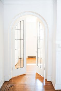 Brilliant arched glass doors, gorgeous wood floors