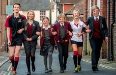 The distinctive maroon Lewes Old Grammar uniform is to be replaced by a more modern grey schoolwear style. Which do you prefer, modern or traditional? (The Argus)