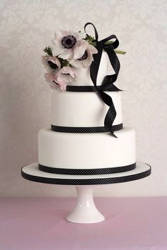 Ribboned plain cake with real flower on top